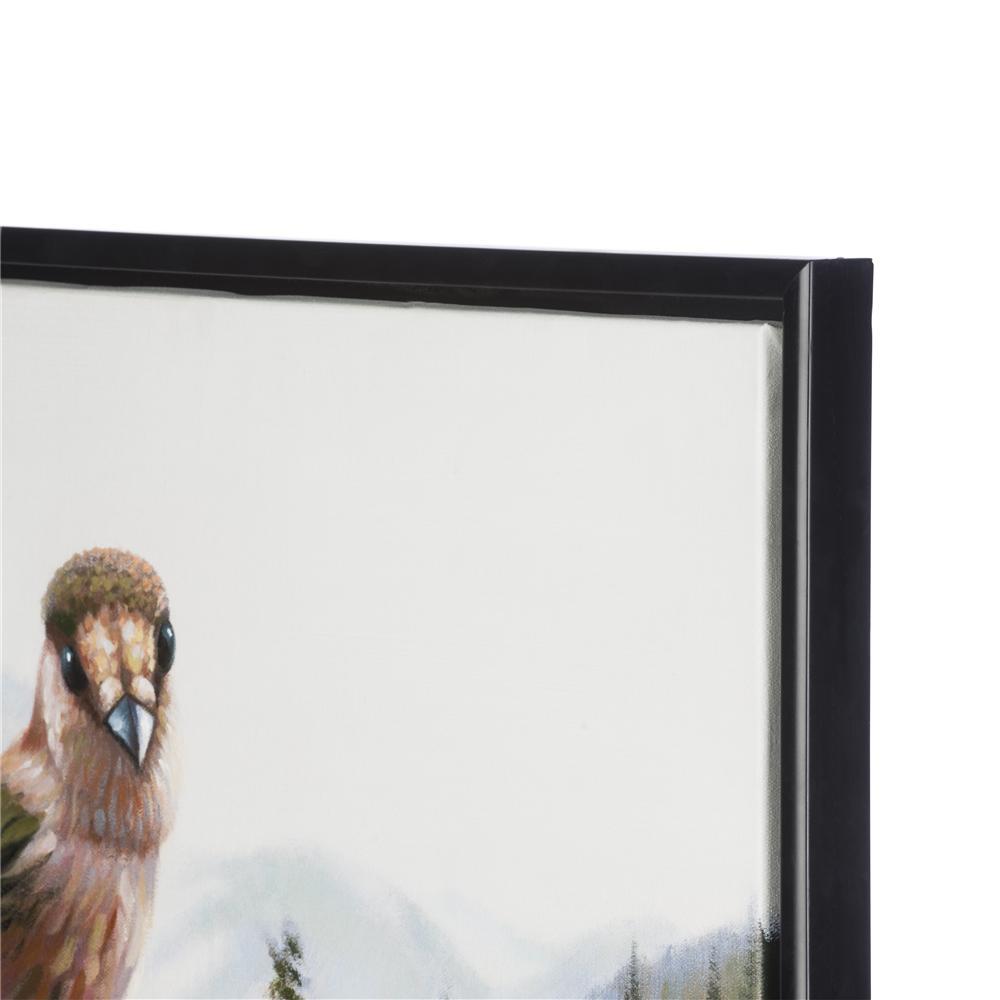 Peinture oiseau sur main devant paysage montagneux