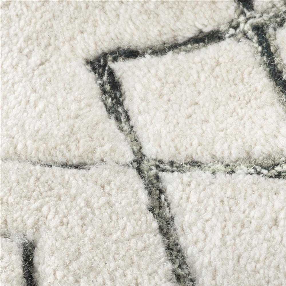 Tapis rectangulaire beige motifs noirs