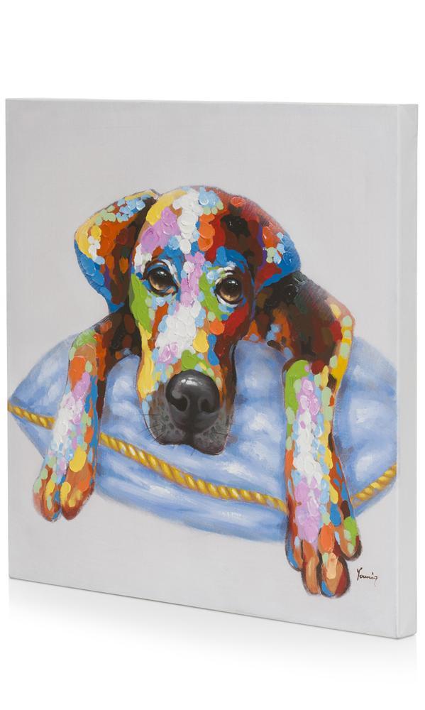 Peinture chien multicolore couché sur coussin