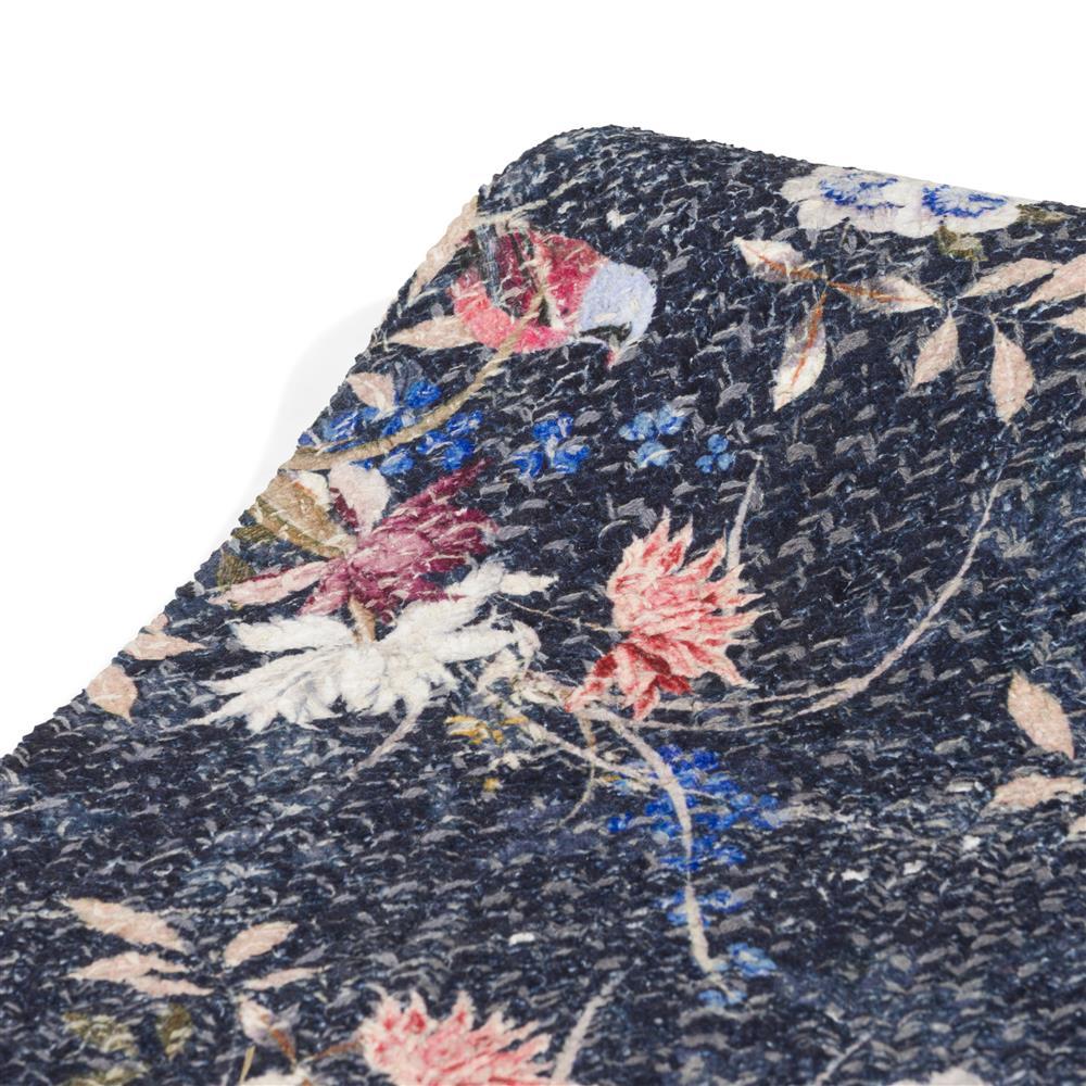 Tapis rond motifs fleurs sur fond bleu nuit