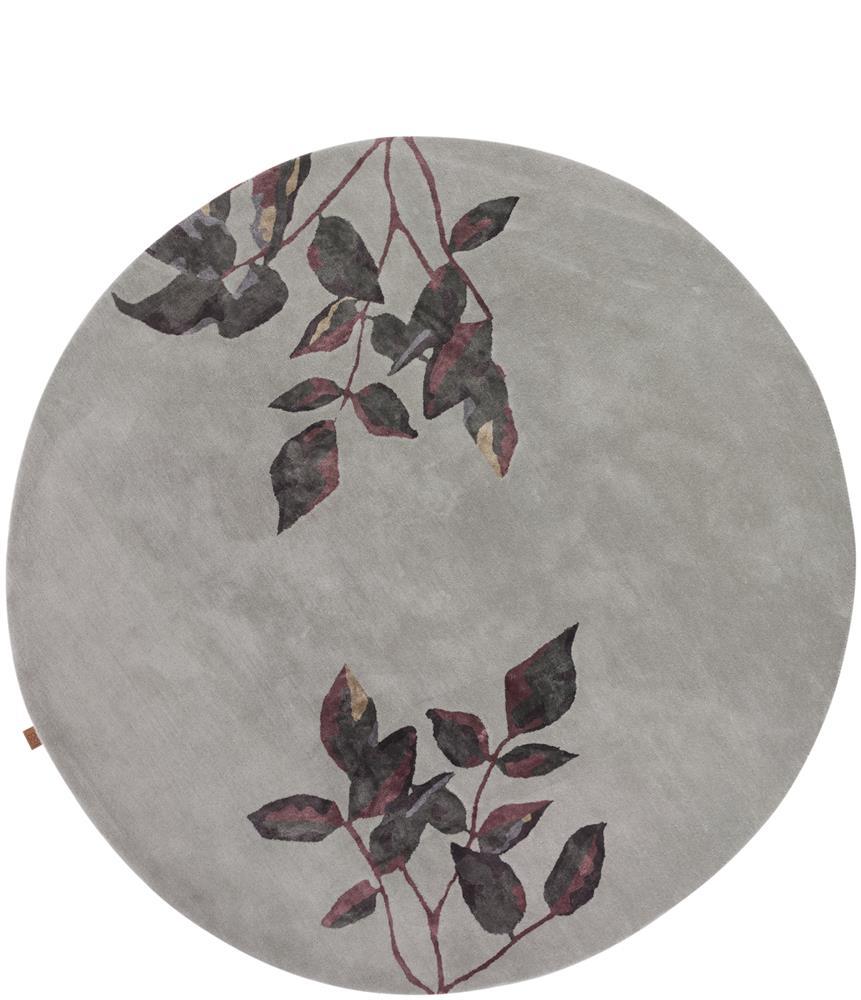 grand tapis rond motifs branches de feuilles