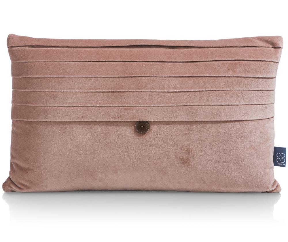 Coussin rectangulaire rose avec un bouton