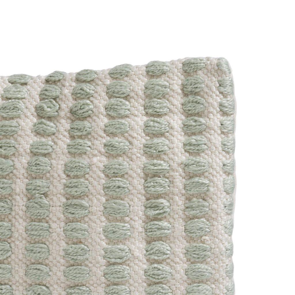 Coussin rectangulaire en tissu beige et vert menthe