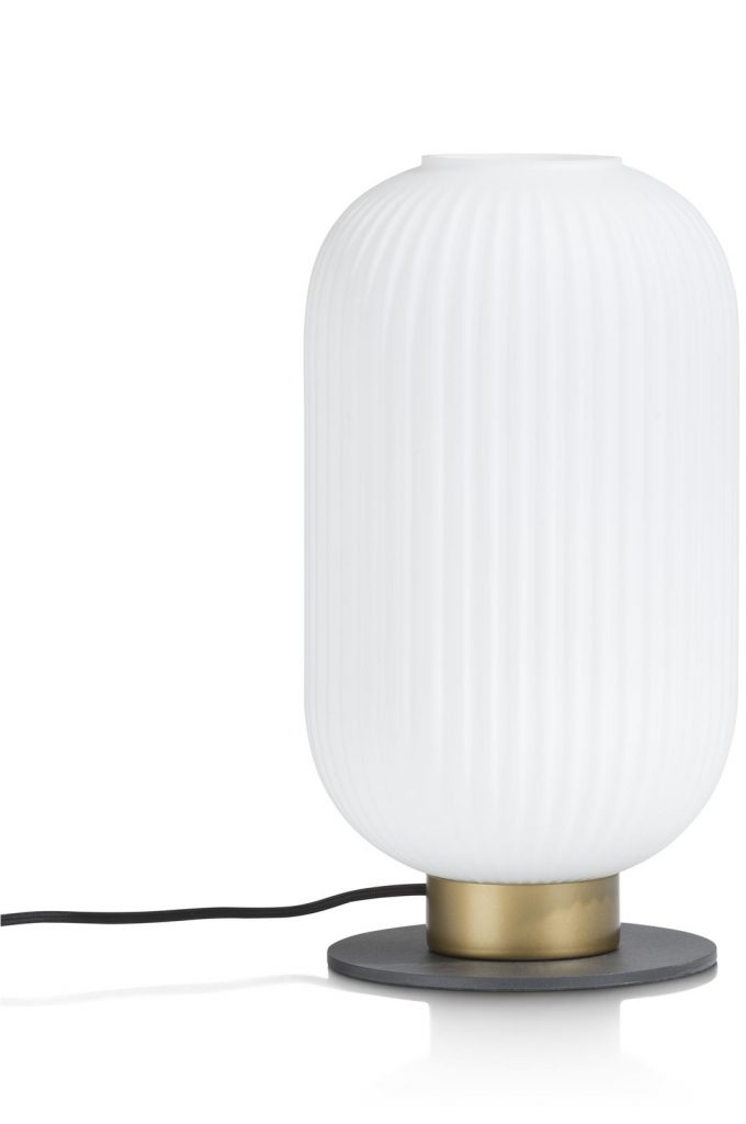 Lampe à poser forme circulaire blanc sur socle en métal doré et noir