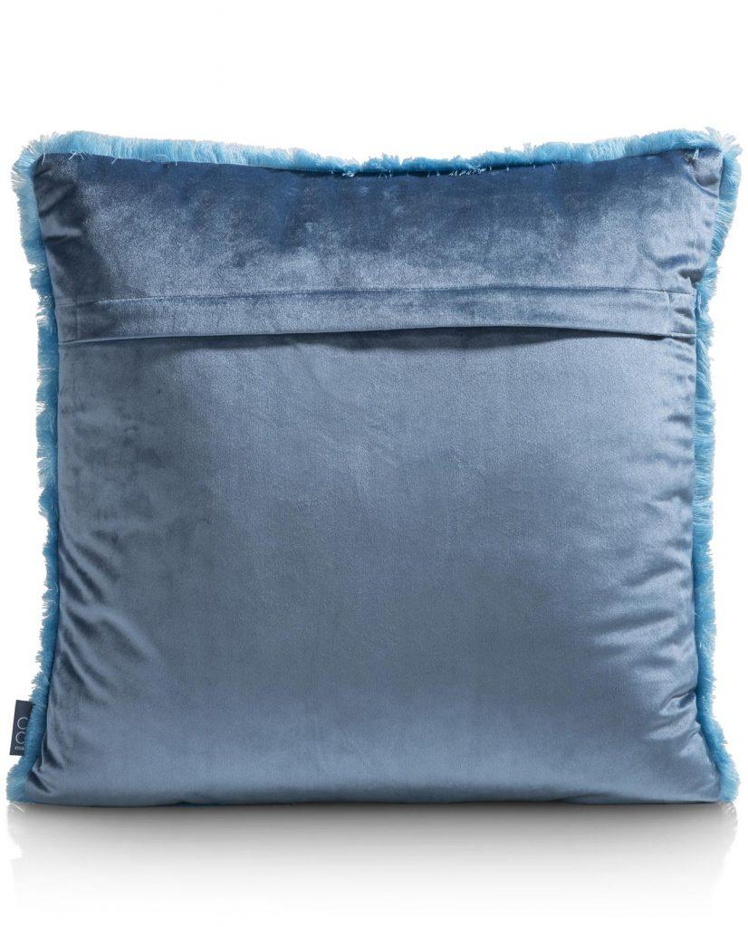 Coussin uni à franges en velours bleu