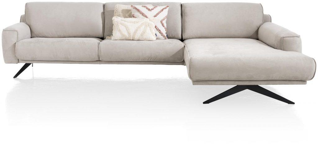 Canapé d'angle contemporain en tissu gris clair et piétement design